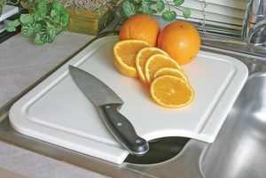 Camco 43857 - Polyethylene White Figured Cutting Board