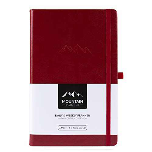 Mountain Daily Planner Classic – Undated Daily Weekly Gratitude Journal, Monthly Calendar. Achieve Goals, Increase Productivity, Boost Happiness in 2021. Hardcover. Pen Holder. 6 Months. Cherry